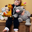 Foto Stock: Girl with toys