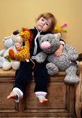 Dívka s hračkami — Stock fotografie