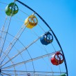 Ferris wheel on blue sky — Stock Photo #5769113