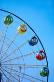 Ferris wheel on blue sky — Stock Photo
