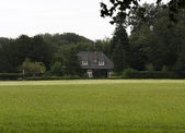 House in a field — Stock Photo