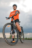 Yong man before starting bike — Stock Photo