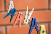 Colorful clothespin hanging on a clothesline — Stock Photo