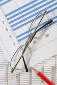 Calculator,Pencil and Glasses on a Graph — Stock Photo