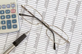 Calculator,Pen and Glasses on Spreadsheet — Stock Photo