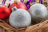 Xmas Baubles in a Basket with Ribbon — Stock Photo