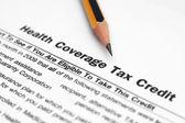 Crédito tributario por cobertura salud — Foto de Stock