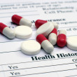 Royalty-Free Stock Photo: Health history and pills