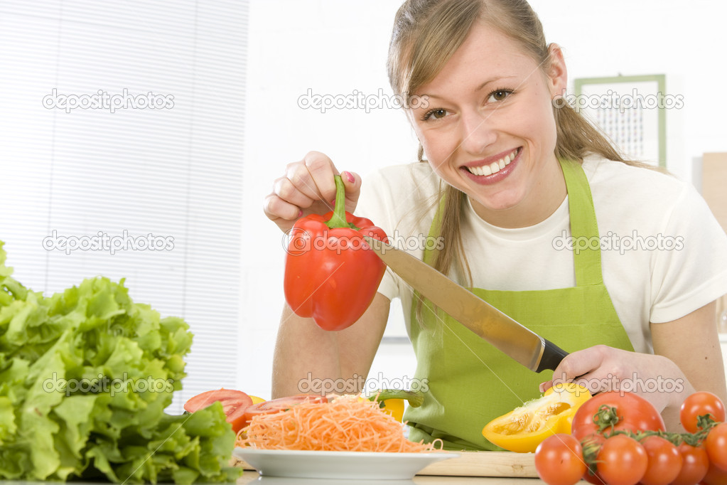 Beautiful young woman making vegetarian vegetable salad — Stock Photo #6452171