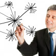 Businessman drawing a social network graph — Stock Photo