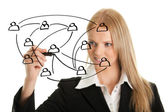 Businesswoman drawing a social network graph — Stock Photo