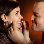 Men taking care of girlfriend's teeth — Stock Photo