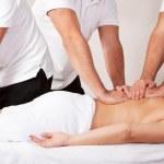 Young beautiful woman getting massage — Stock Photo #6619646