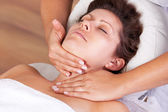 Young beautiful woman getting facial massage — Stock Photo
