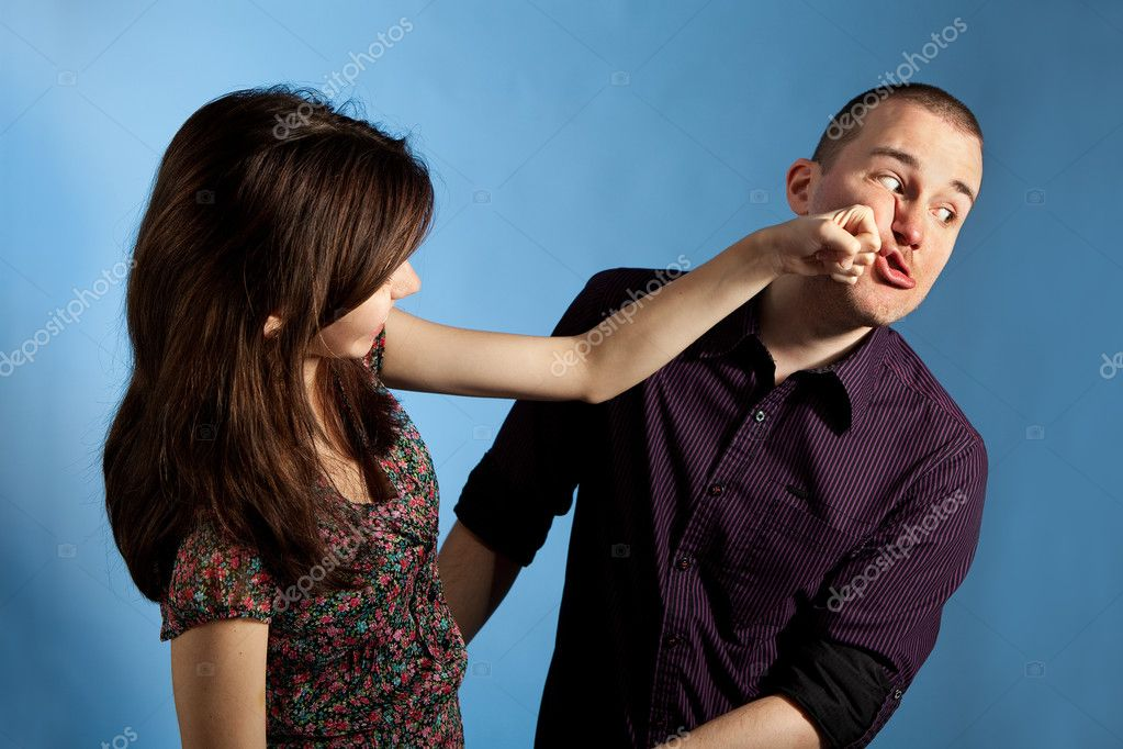 Women punching men - Stock Image