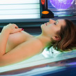 Young woman in solarium — Stock Photo