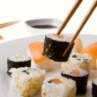 Picking up a sushi roll — Stock Photo
