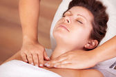 Young beautiful woman getting shoulders massage — Stock Photo