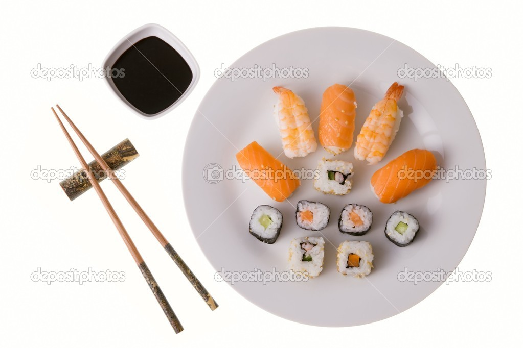 Variety of sushi rolls: Nigiri Sushi salmon and king prawn; California rolls and Makizushi. Soy sauce and chopsticks. Isolated on white — Stock Photo #6630627