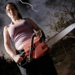 Woman with chainsaw — Stock Photo #6262500