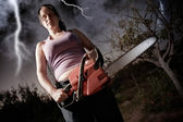 Woman with chainsaw — Stock Photo
