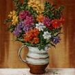 Freesia in a milk jug — Stock Photo