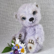 Lilac teddy-bear with a bunch of — Stock Photo