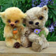 Teddy-bears among flowers — Stock Photo