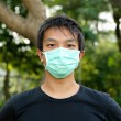 Royalty-Free Stock Photo: Young man wearing face mask