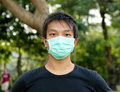 Young man wearing face mask — Stock Photo