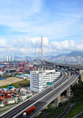 Bridge and container terminal in Hong Kong — Stock Photo