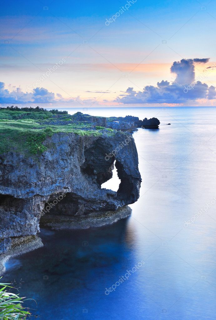 Sunset on the rocks , in Okinawa , Manzamo  Stock Photo #5398463