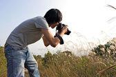 Photographer taking photo — Stock Photo