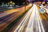 Moving cars at night — Stock Photo