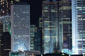 Business buildings at night in Hong Kong — Stok fotoğraf