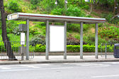 Blank billboard on bus stop — Stockfoto