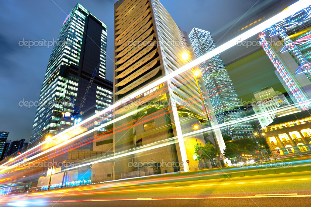 Light trails on the modern building background in Hong Kong — Stock Photo #5936565