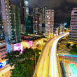 Modern city and highway at night — Stock Photo