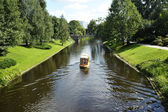 Walking boat on the city channel in Riga (Latvia) — Stock Photo