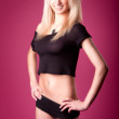 Hot blonde girl on pink background — Stock Photo