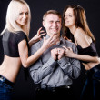 Brunette and blonde girls, attack guy — Stock Photo