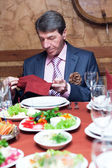 Elderly man enjoys a dinner — Stock Photo
