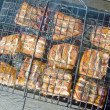 Grilled pieces of fish on the grill — Stock Photo