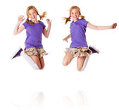 Happy identical twins jumping and laughing — Stock Photo