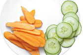 Carrot and cucumber slices in white plate. — Stock Photo