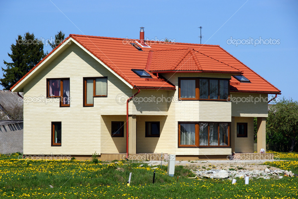 Modern apartment house on a background of a green grass — Stock Photo #5682729