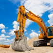 Yellow Excavator at Construction Site -  