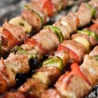Barbecue with delicious grilled meat on grill — Stock Photo #5823926