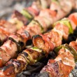 Barbecue with delicious grilled meat on grill — Foto de Stock