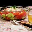 Ready made typical and traditional salad of tomatoes, cucumber and cheese - Stock Photo
